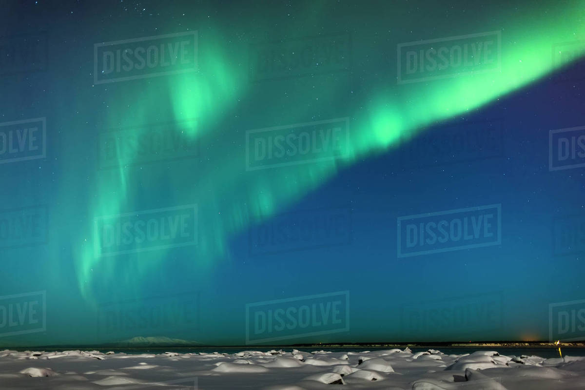 The Northern Lights Dance In The Night Sky Above Knik Arm And Mount