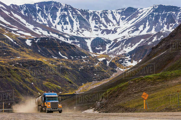 A semi-truck ascends through Atigun Pass along the Dalton Highway; Alaska, United States of America Rights-managed stock photo