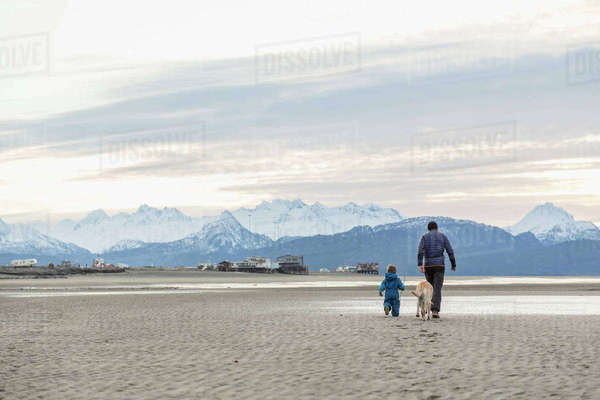 Father and son play on beach on the Homer Spit, Kenai Peninsula, Southcentral Alaska. Rights-managed stock photo