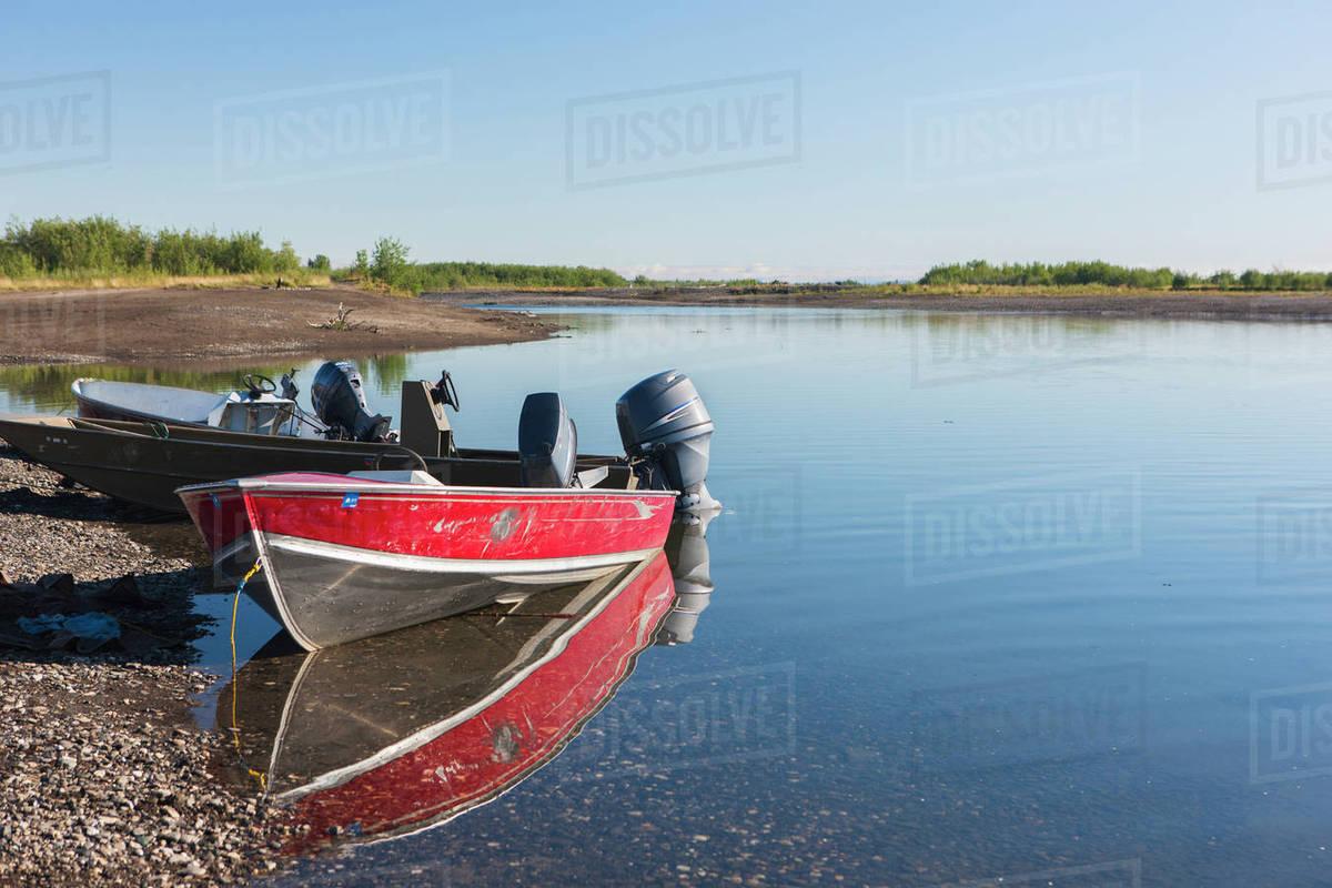 Aluminum boats float near the shore of the Noatak River, Noatak, Arctic  Alaska, USA, Summer stock photo