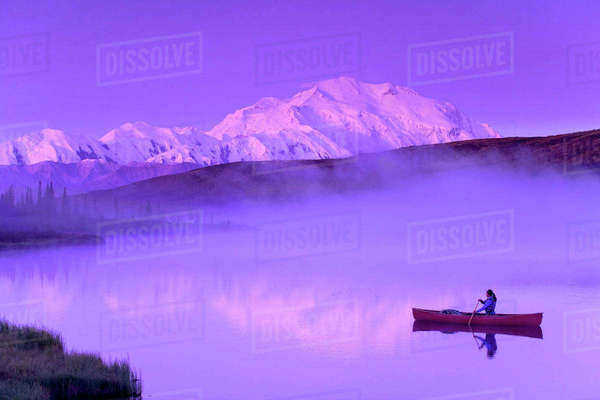 Person Canoeing On Wonder Lake Mt.Mckinley Bkgrd Alaska In Summer Rights-managed stock photo