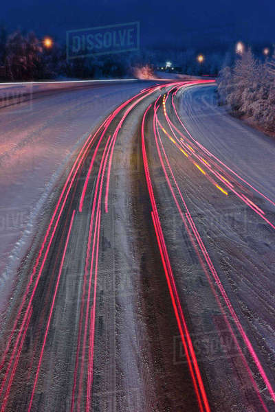 Rush Hour Commmuter Traffic On The Glen Highway During A Snow Storm In Anchorage, Alaska Rights-managed stock photo
