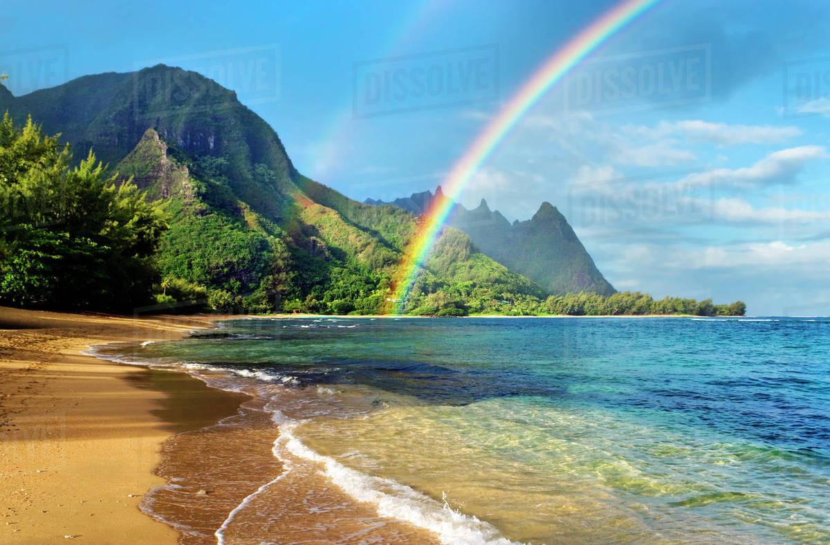 hawaii kauai haena beach tunnels beach rainbow over coastline