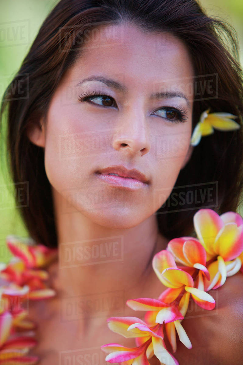 Usa hawaii woman with yellow plumeria behind ear and plumeria lei usa hawaii woman with yellow plumeria behind ear and plumeria lei around her neck oahu izmirmasajfo