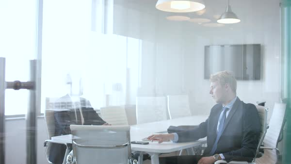 Two businessmen discussing at conference room. Royalty-free stock video