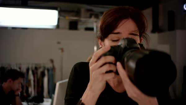 Female photographer photographing at studio. Royalty-free stock video