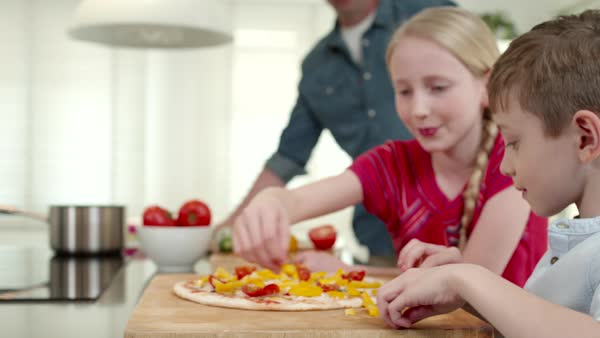 Father with children preparing pizza at kitchen. Royalty-free stock video