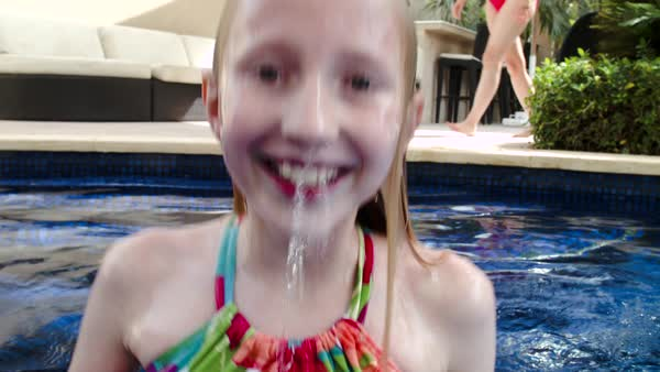 Girl playing in swimming pool. Royalty-free stock video