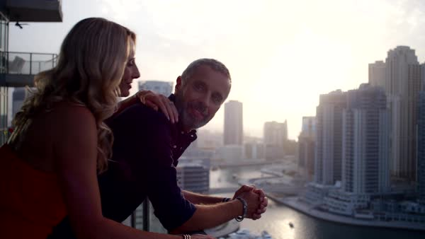Couple looking out from balcony. Royalty-free stock video