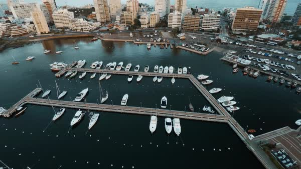Aerial view of boats docked in marina near resorts, Punta del Este, Uruguay Royalty-free stock video