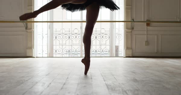 Ballerina performing pirouettes in studio, slow motion Royalty-free stock video