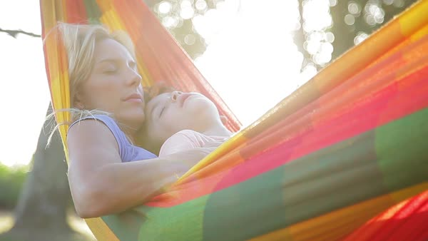 Mother and young son napping together in hammock Royalty-free stock video