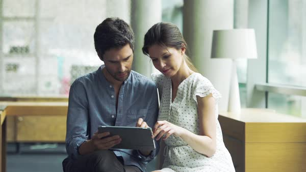 Couple using digital tablet together Royalty-free stock video