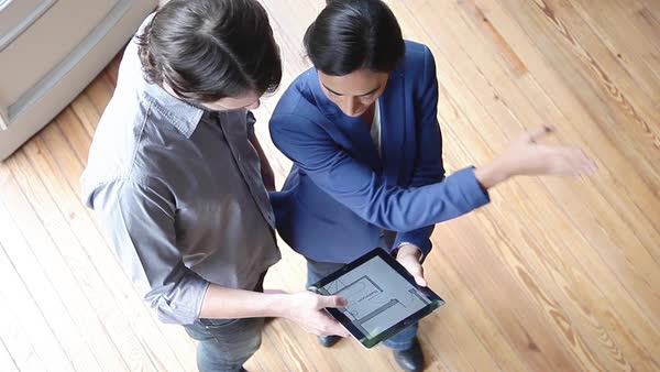 Couple looking at blueprint on digital tablet Royalty-free stock video