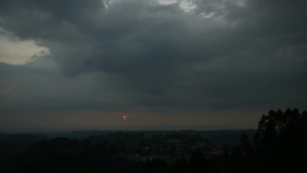 Timelapse view of sun setting in overcast sky Royalty-free stock video