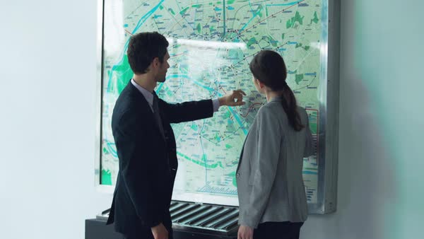Couple looking at subway map making travel plans Royalty-free stock video
