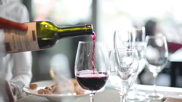 Close-up of red wine being poured into glass in restaurant Royalty-free stock video
