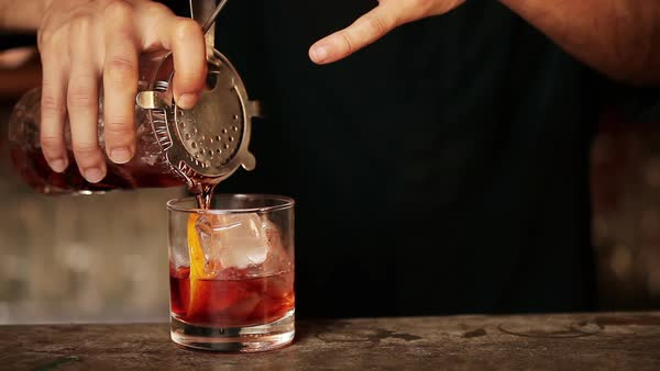 Bartender pouring cocktail into glass Royalty-free stock video