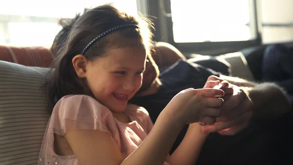 Father and daughter looking at smartphone together Royalty-free stock video