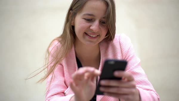 Young woman using smartphone and smiling Royalty-free stock video