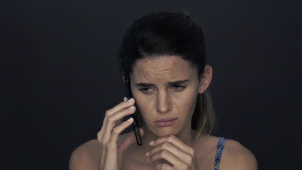 Woman receiving sad news on cell phone Royalty-free stock video
