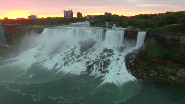Flying aerial over Niagara Falls at sunrise from the Canada side. Royalty-free stock video