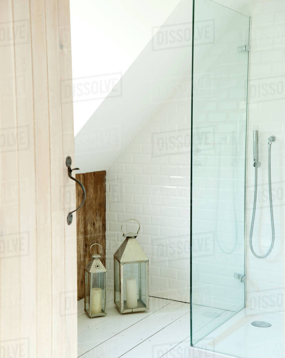 Lanterns and shower cubicle in bathroom of cottage conversion, UK ...