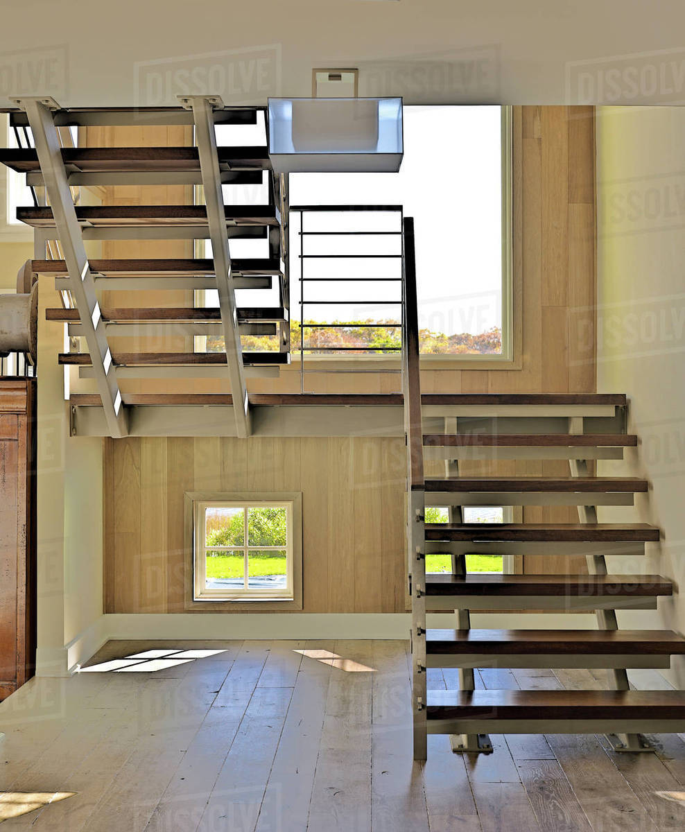 Staircase With Open Treads In Hallway With Wooden Floor Stock Photo