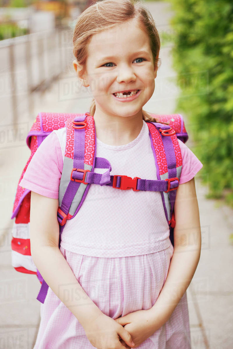 5 Year Old Schoolgirl with Pink School Bag Smiling with ...  5 Year Old Scho...