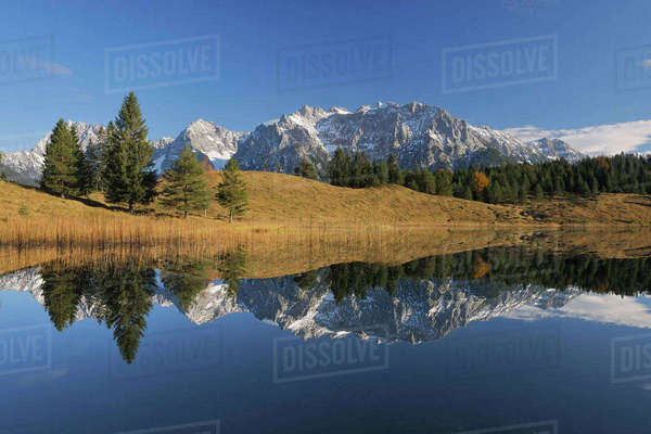 Wildensee with Karwendel Mountains in Autumn, Mittenwald, Garmisch-Partenkirchen, Upper Bavaria, Bavaria, Germany Royalty-free stock photo