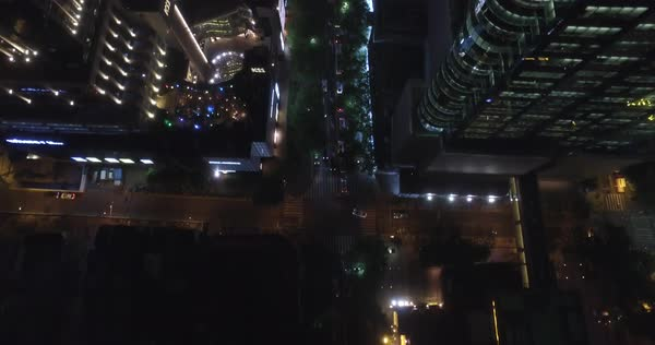 Looking Down At Huaihai Middle Road With Bright Billboards And Traffic Shanghai China Cityscape Drone