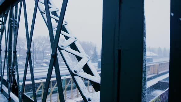 Snowfall covers the trestle of a walking bridge. Royalty-free stock video