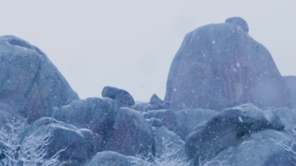Snow falling on a rock formation. Royalty-free stock video