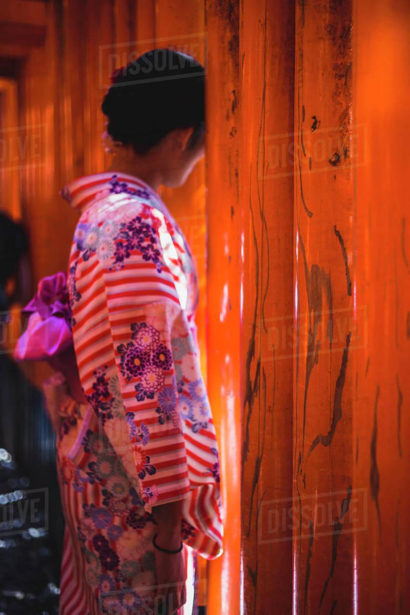 Woman in a kimono at Fushimi Inari shrine in kyoto, japan Royalty-free stock photo