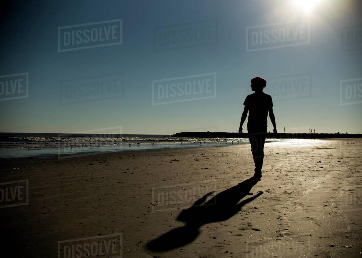 Young man walking on Galveston Texas beach Royalty-free stock photo