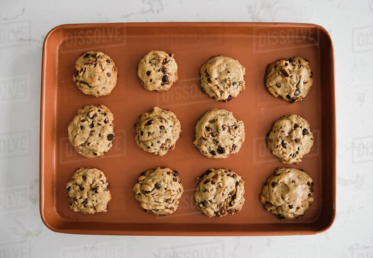 Sheet pan of freshly baked chocolate chip cookies shot from above Royalty-free stock photo