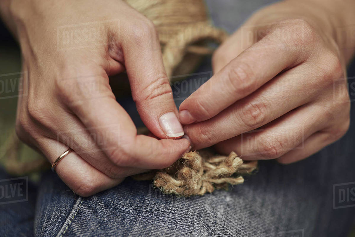 Dressing, manual labor making and Cutting the rope Royalty-free stock photo