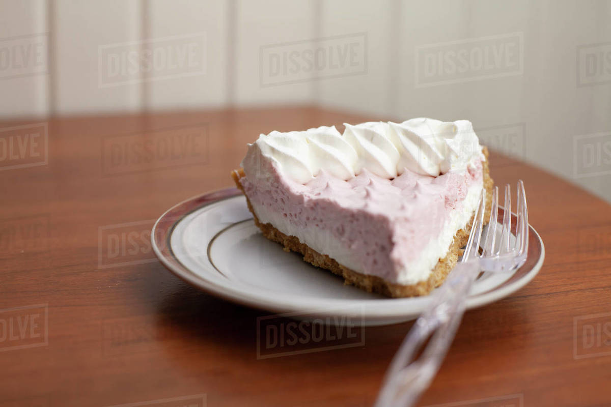 One Slice of Strawberries and Cream Pie on a Serving Plate Royalty-free stock photo