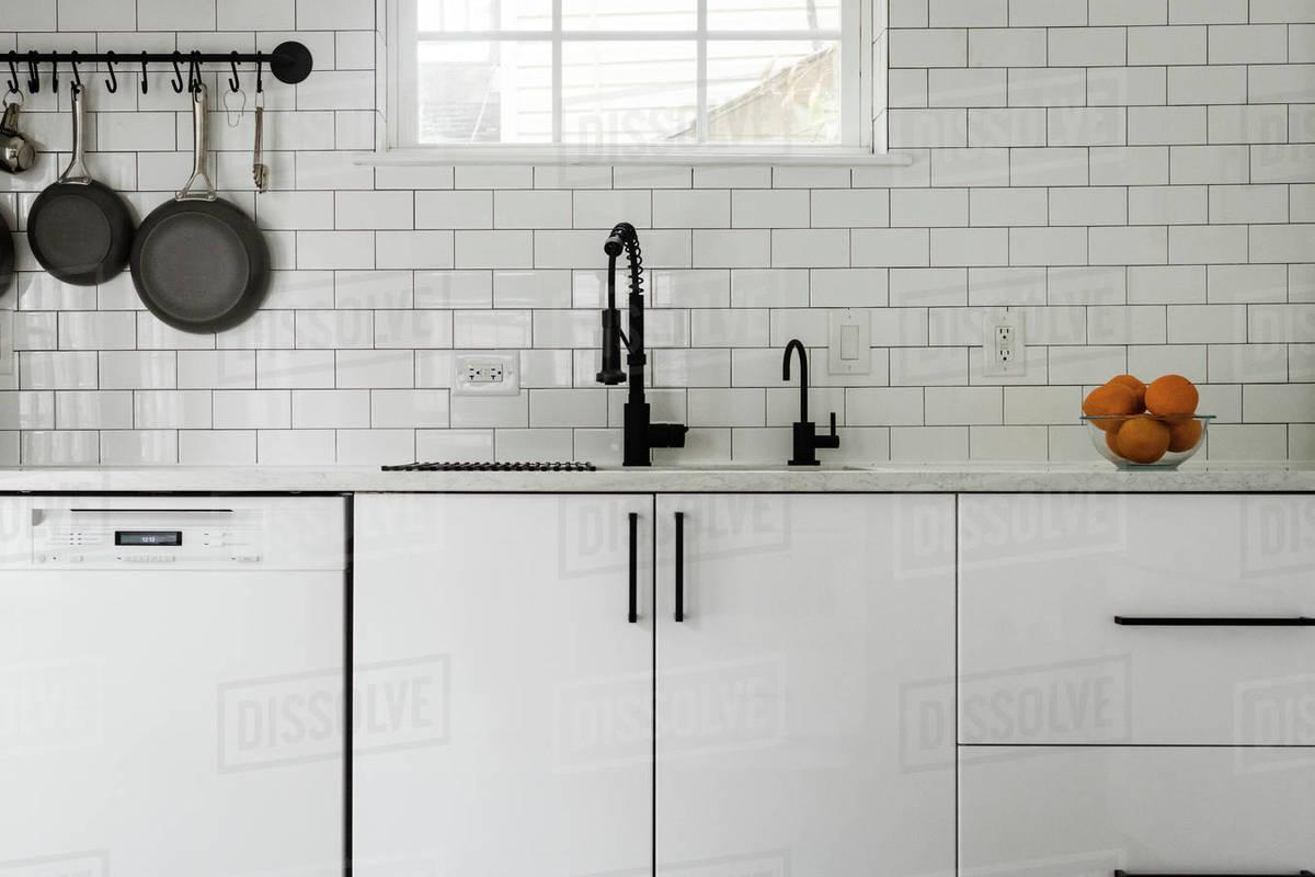- Kitchen Sink And White Subway Tile Backsplash - Stock Photo - Dissolve