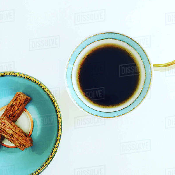 Overhead view of coffee cup and snacks on white table Royalty-free stock photo