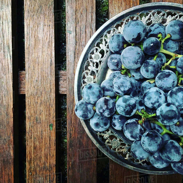 High angle view of grapes in plate on jetty Royalty-free stock photo