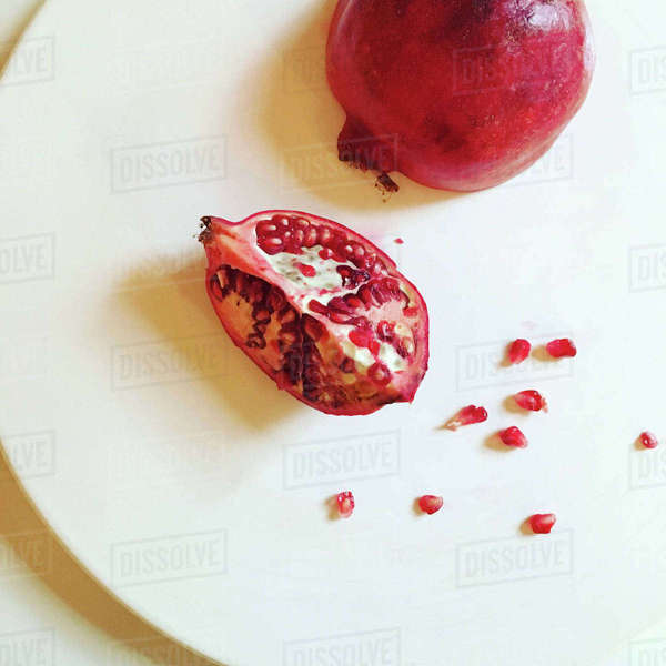 High angle view of pomegranate in white plate on table Royalty-free stock photo