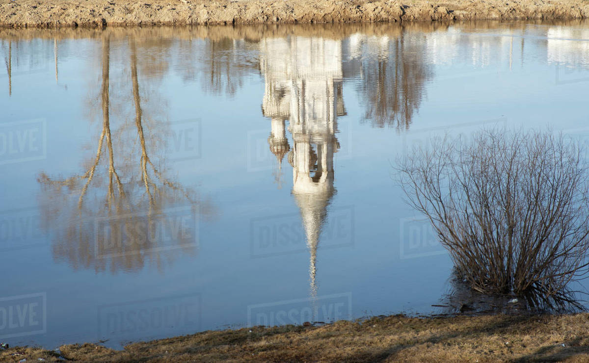 Reflection of Church and tree in the river Royalty-free stock photo