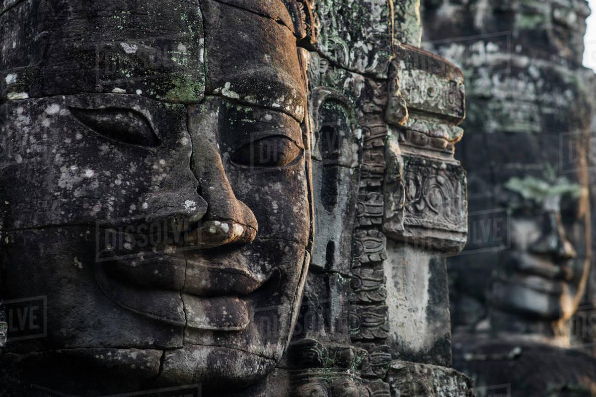 Stone head at Bayon, Angkor Thom temple, Angkor Wat complex, Siem Reap, Cambodia. Royalty-free stock photo