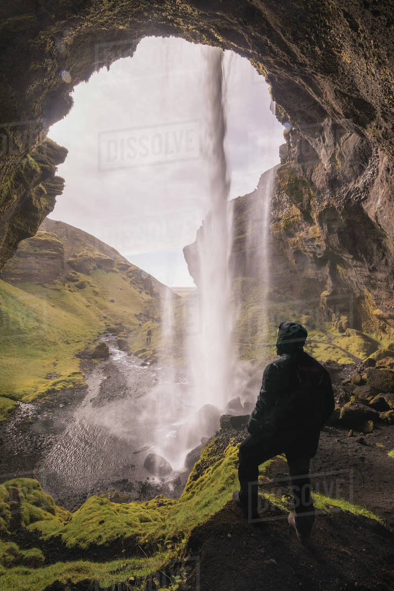 Man observing the size of a waterfall Royalty-free stock photo