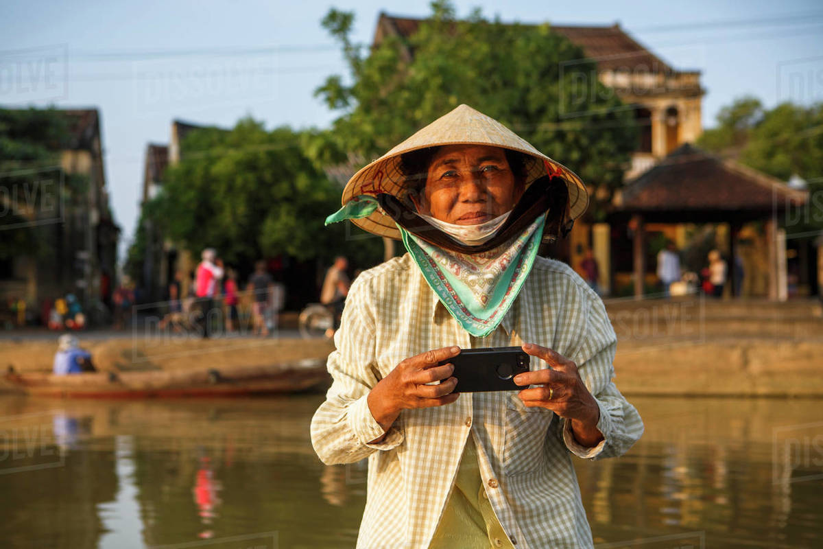 A Boat Guide Prepares to Take a Photo for Travelers in Hoi An, Vietnam Royalty-free stock photo