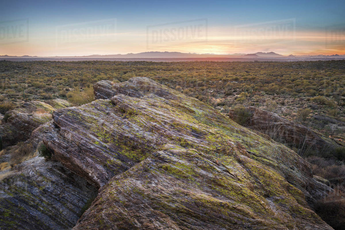 Desert landscape with rock formations at sunset. Royalty-free stock photo