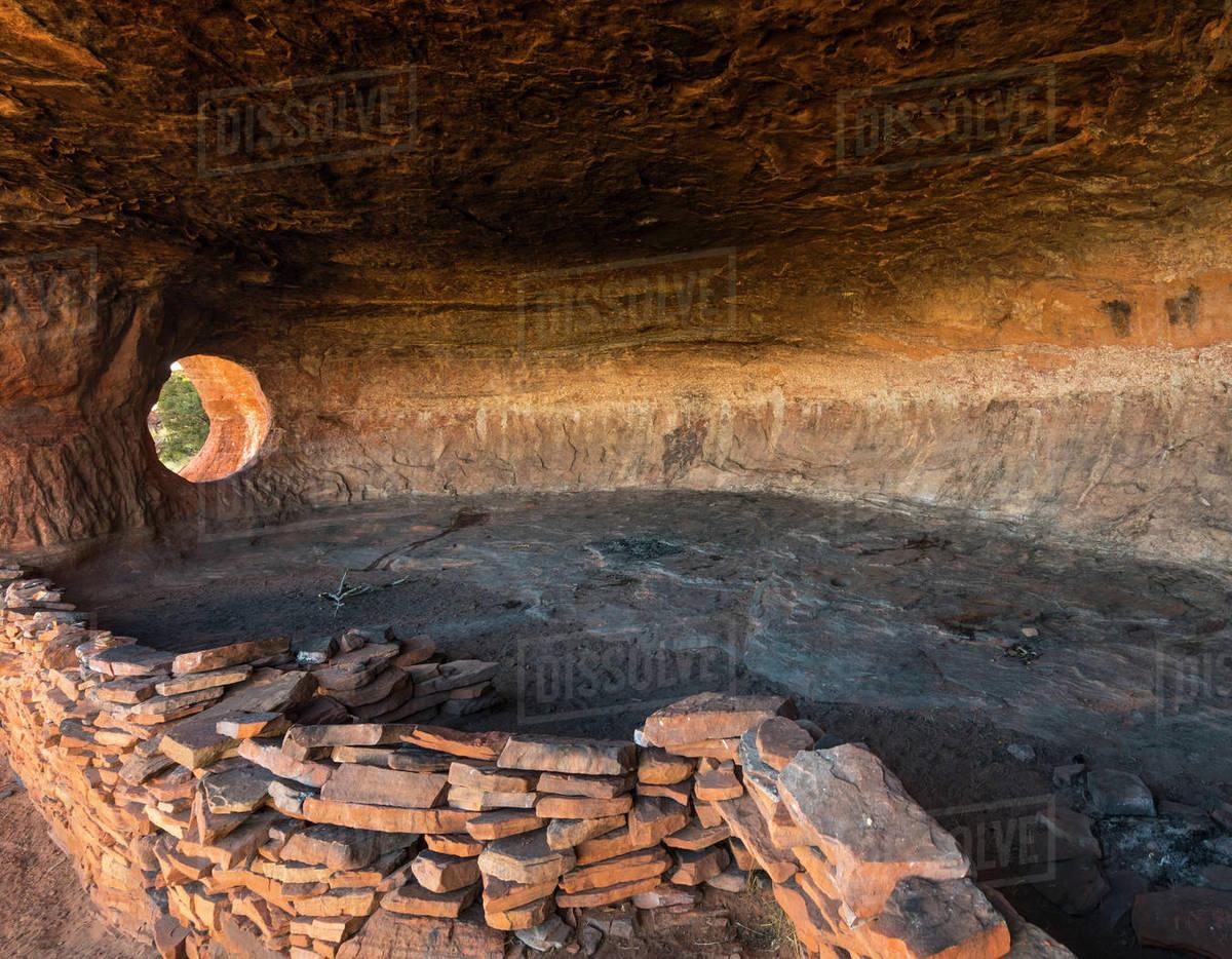 Cave with natural rock arch near Sedona, Arizona. Royalty-free stock photo