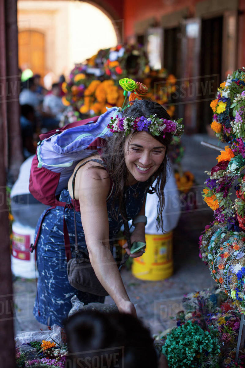 Woman buying flowers from local vendor, San Miguel de Allende, Mexico Royalty-free stock photo