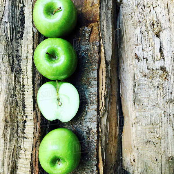 Overhead view of Granny Smith apples arranged on broken table Royalty-free stock photo